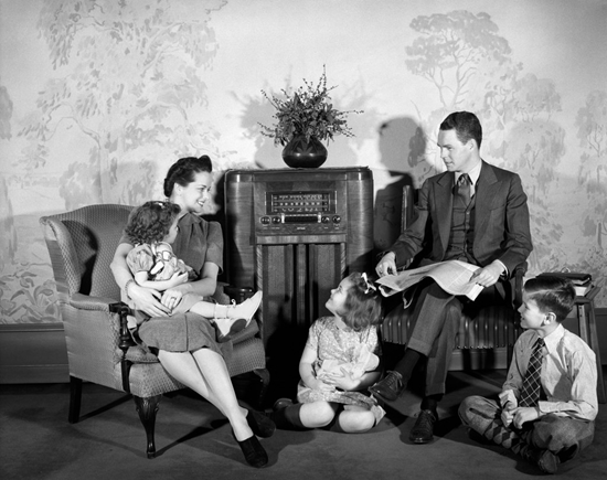 Old photo of traditional family around a radio