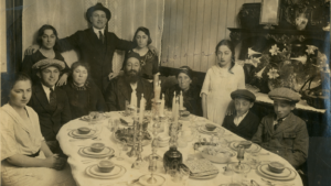 Early photograph of Jewish family celebrating the Seder dinner