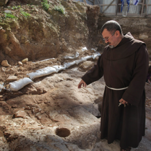 Father Jack Karam of the Basilica of the Annunciation walks thorough the remains of the dwelling in Nazareth, Israel