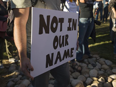 """""""Not in our name"""" sign condemning the vandalism of a local Islamic mosque"""