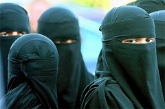 Muslim women wearing covered heads (hijab)