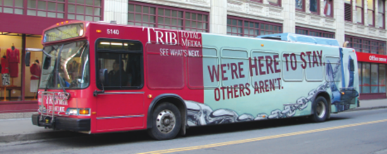 Port Authority of Allegheny County bus ad - we're here to stay, others aren't